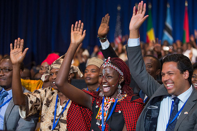 People taking part in the Young African Leaders Initiative town hall raise their hands as President Barack Obama delivers remarks a the summit in Washington, D.C., July 28, 2014. (Official White House Photo by Pete Souza)